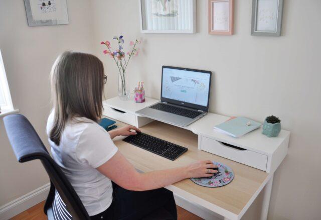 B2B freelance copywriter working at desk with laptop